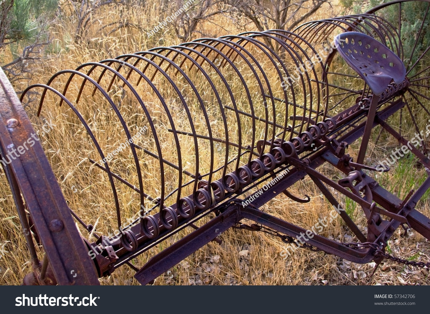 Farm Implement Pieces : A rusting piece of farm equipment in an overgrown field