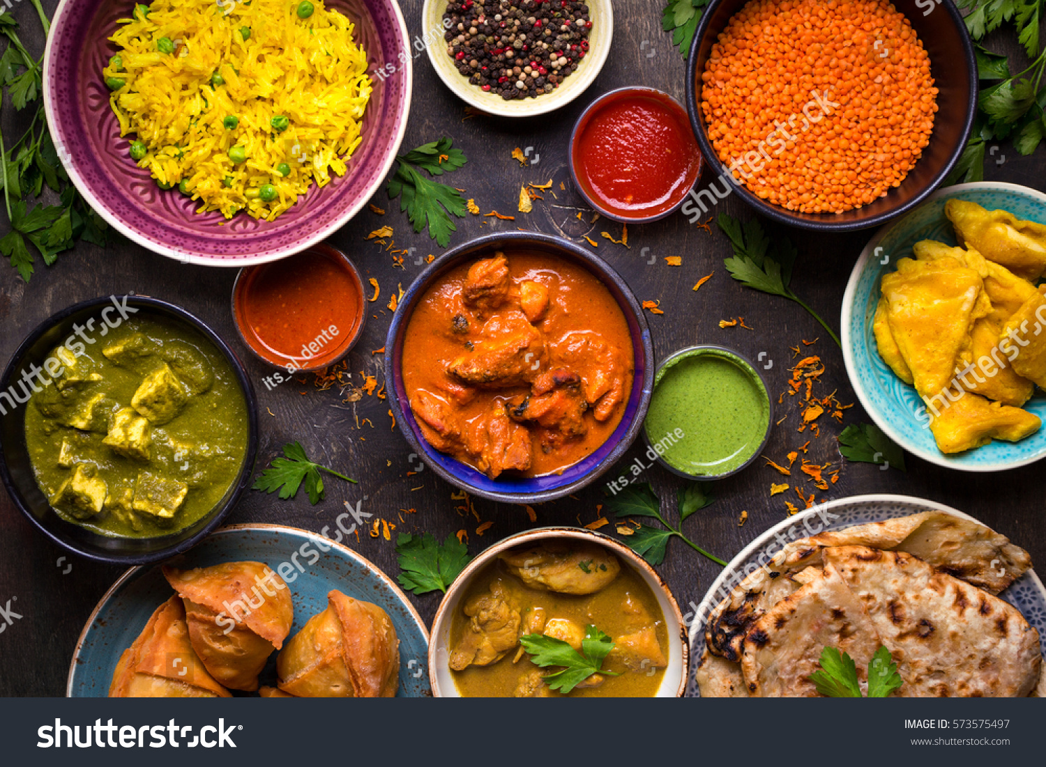 Assorted indian food on dark wooden stock photo 573575497 for About indian cuisine