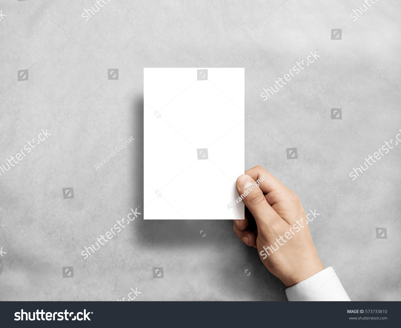 hand holding blank white vertical postcard stock photo 573733810, Presentation templates