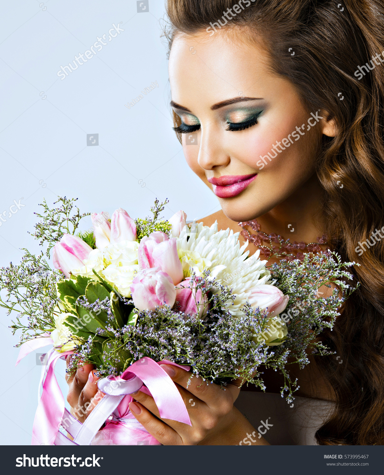 Beauty Portrait Of A Beautiful Girl With Bright Spring Bouquet Girl