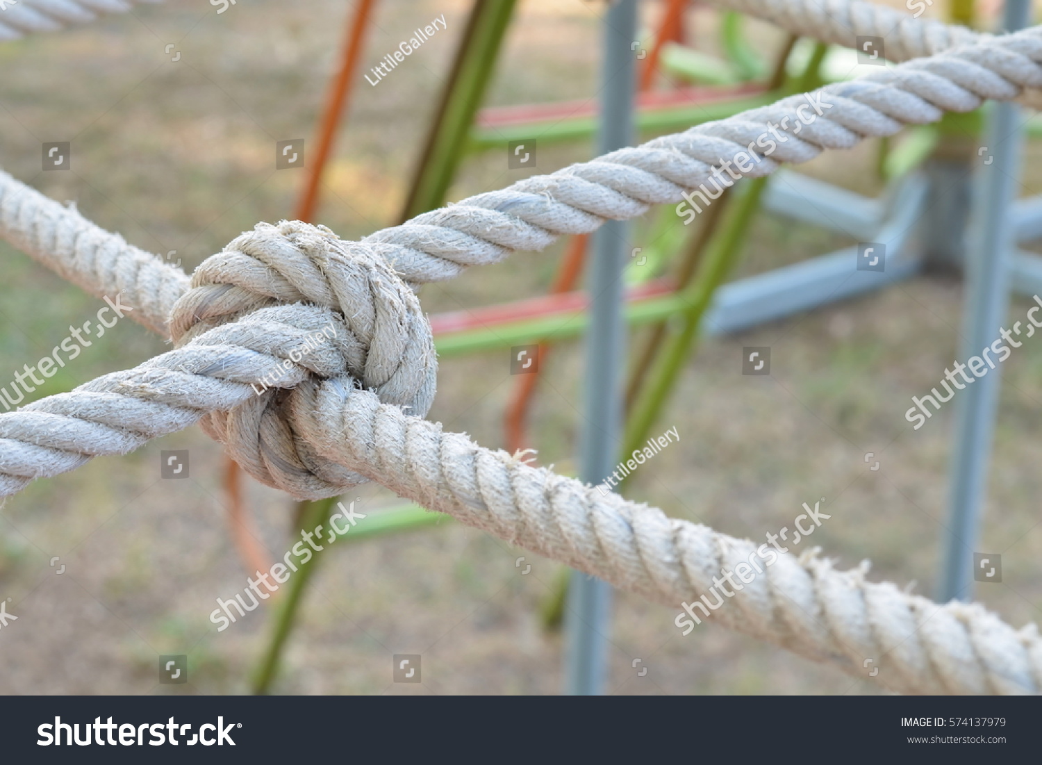Rope knot line tied together playground stock photo 574137979 rope knot line tied together with playground backgroundas a symbol for trust teamwork or biocorpaavc Choice Image