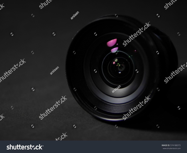 Closeup camera len photographer on dark background wallpaper low-key #574188373