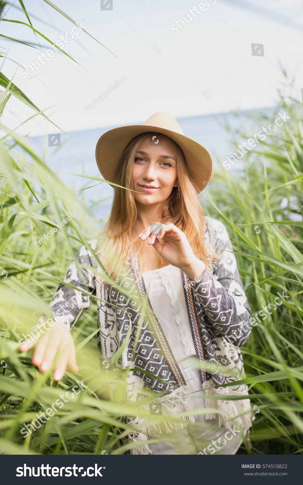 girl walking high grass stock photo edit now 574510822 shutterstock