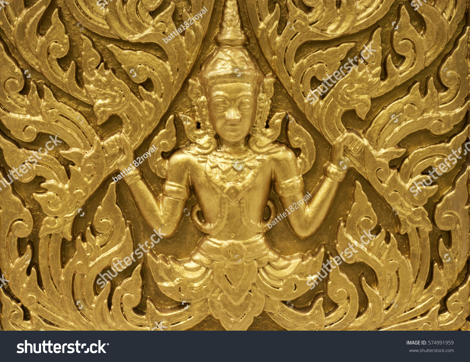 Details of a fine wood carving art. A Buddhist art and craft.In the ...