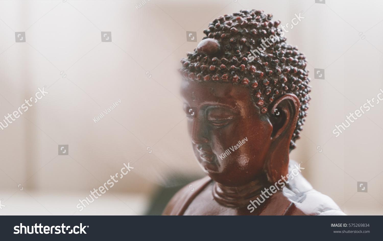 Statue buddha nirvana symbols buddhism around stock photo 575269834 statue of buddha in nirvana symbols of buddhism around the world unfocused texture buycottarizona Image collections