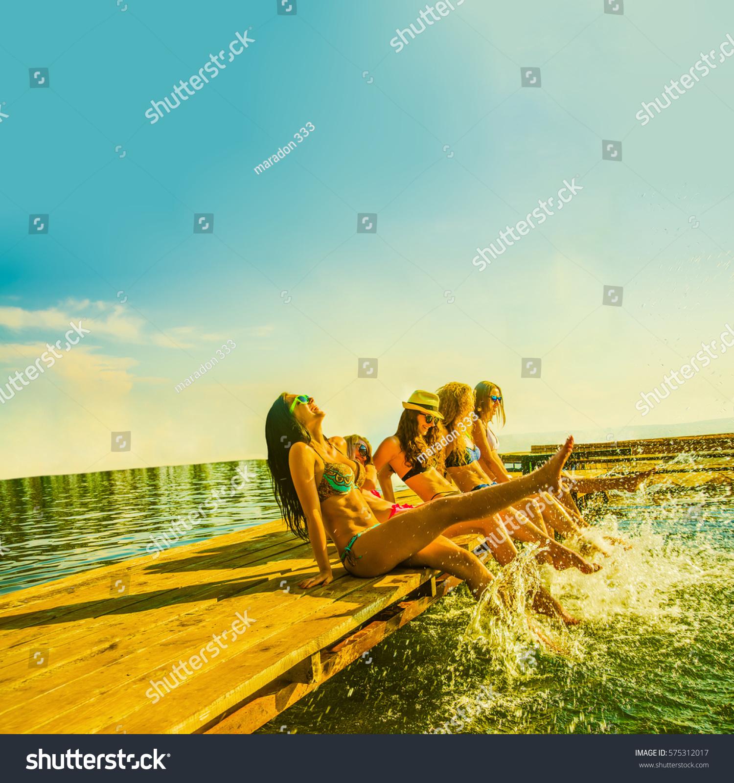 Happy Beautiful Woman Enjoying At Beach Stock Photo: Group Happy Young Woman Feet Splash Stock Photo 575312017