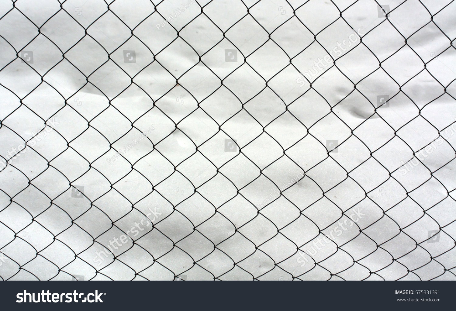Wire mesh fence and snow. Abstract seasonal background for design ...