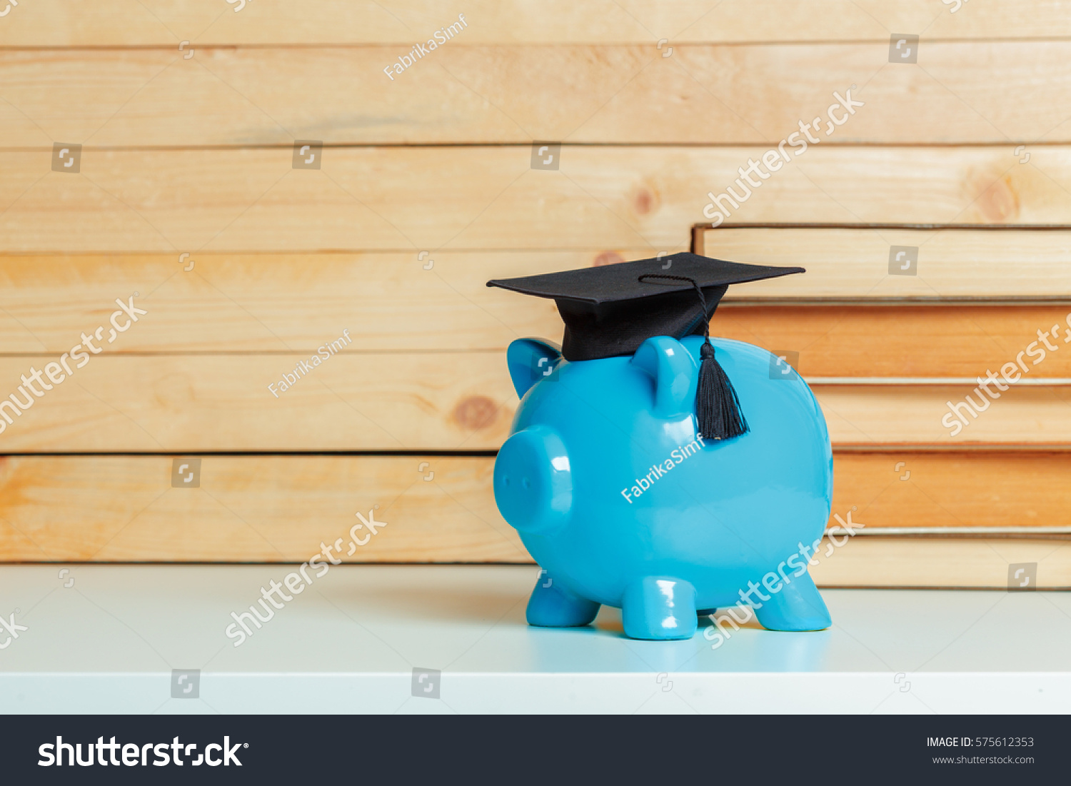 college graduate student diploma piggy bank stock photo  college graduate student diploma piggy bank