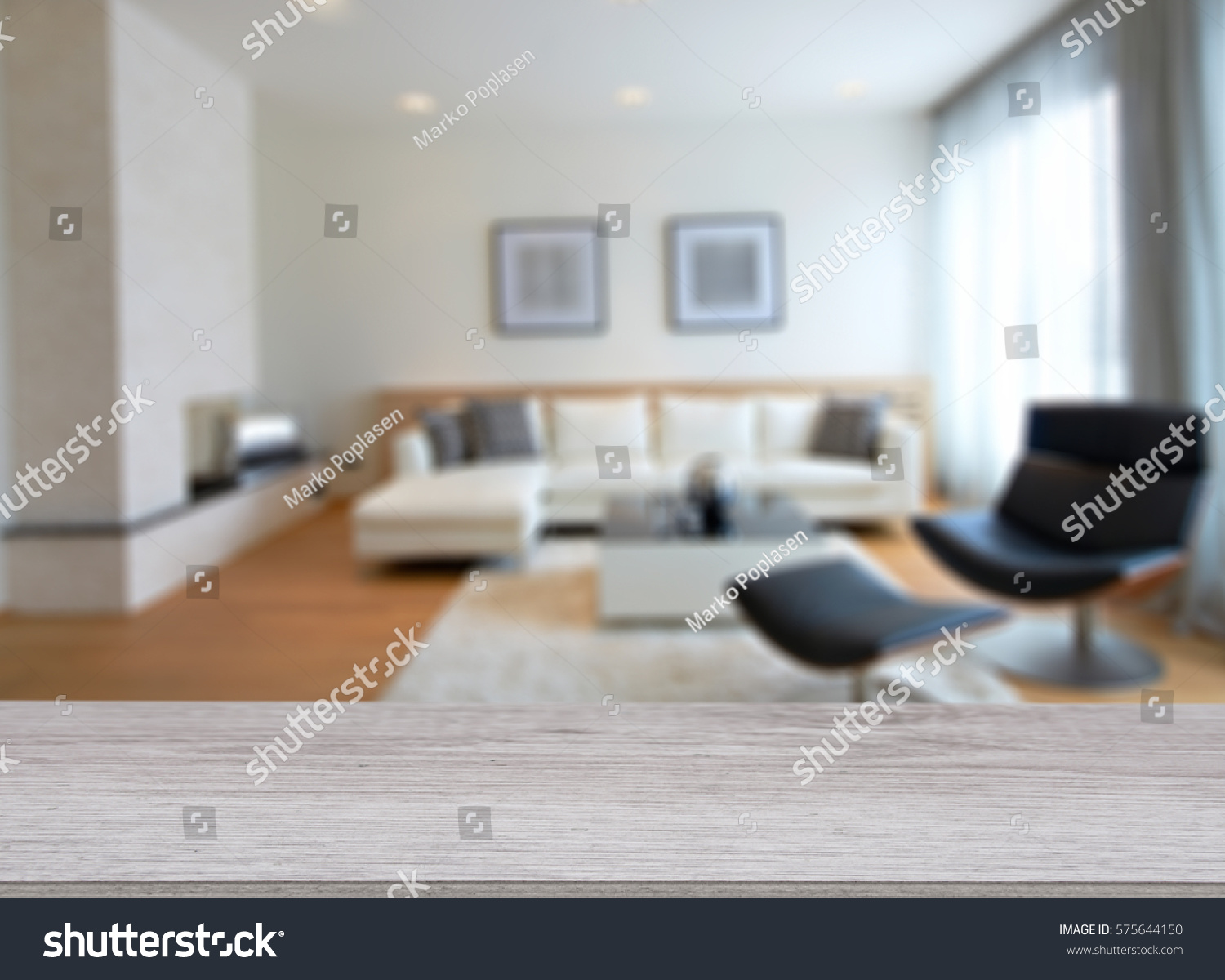 Empty wood table and blurred living room background stock photo - Wooden Board Empty Table In Front Of Blurred Background Perspective Light Wood Over Blur In