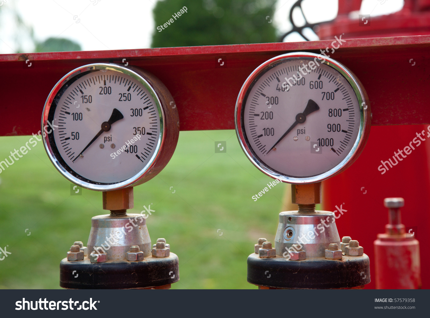 Heavy Equipment Gauges : Two similar pressure gauges on heavy equipment stock photo