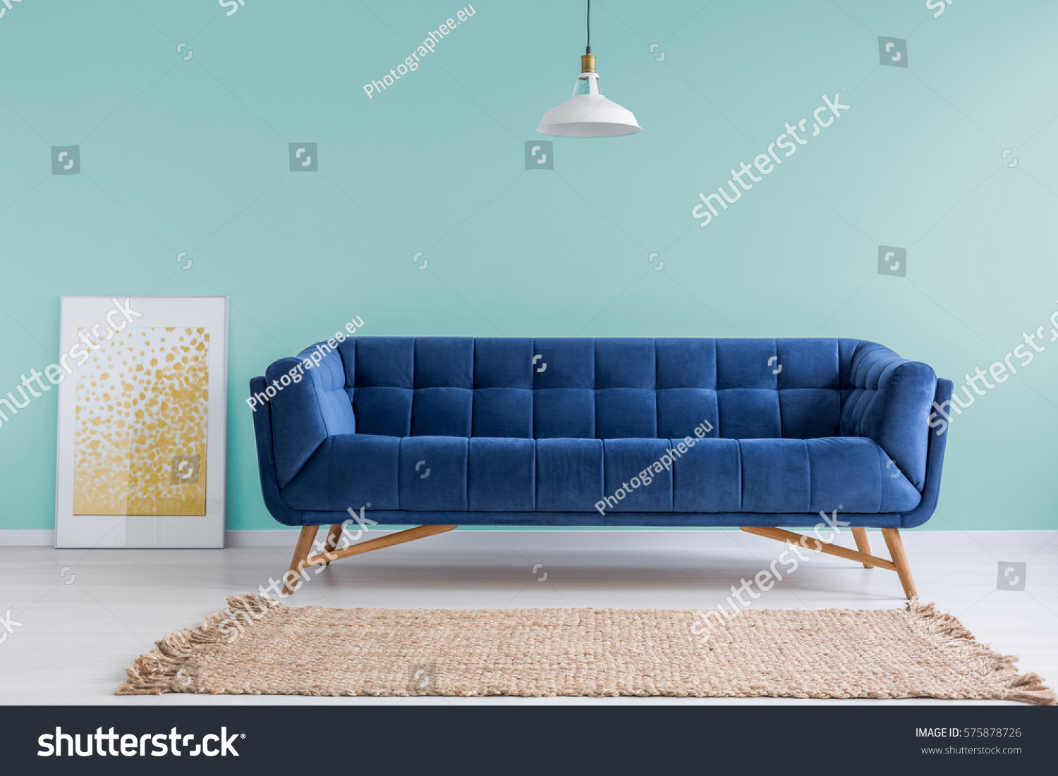 Mint Living Room With Blue Sofa, Rug And Lamp