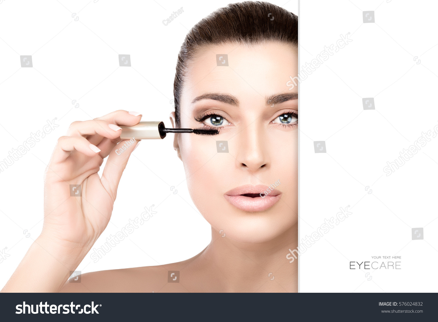 Gorgeous Beauty Model With Bright Makeup Applying Mascara To Her