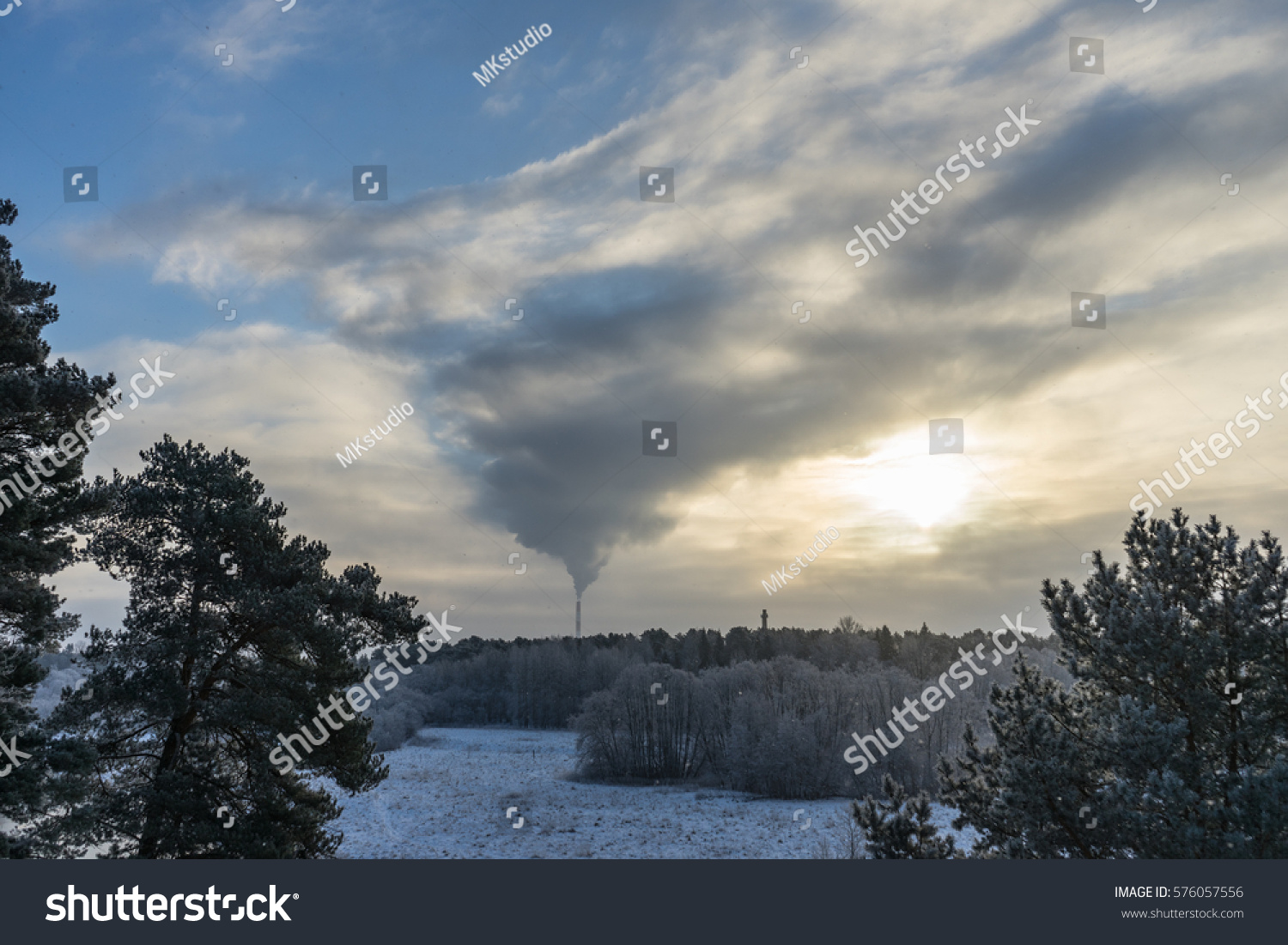 Air pollution smoke from pipes and factory with winter background #576057556