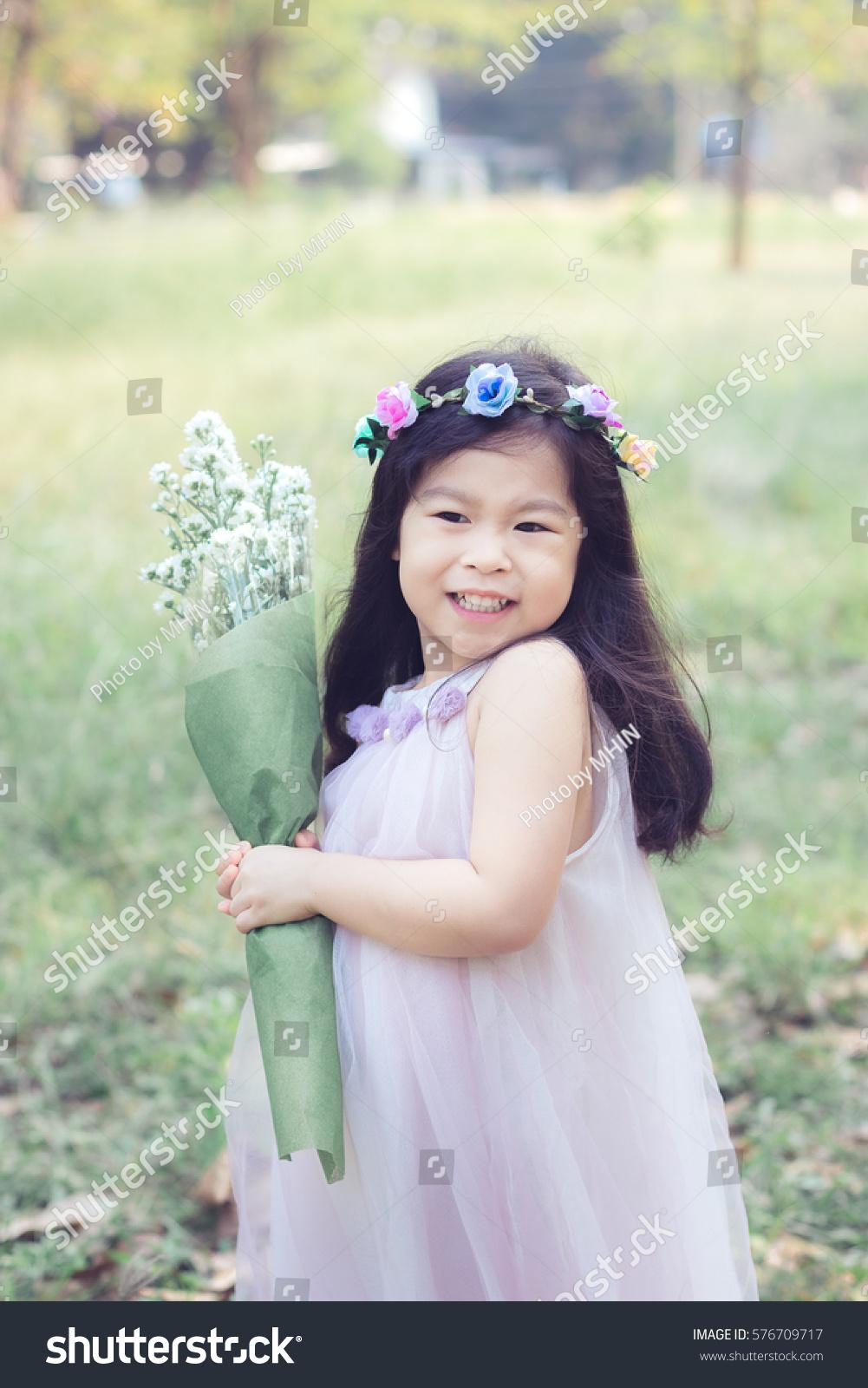 Asian little cute girl flower crown stock photo download now asian little cute girl with flower crown in the garden izmirmasajfo