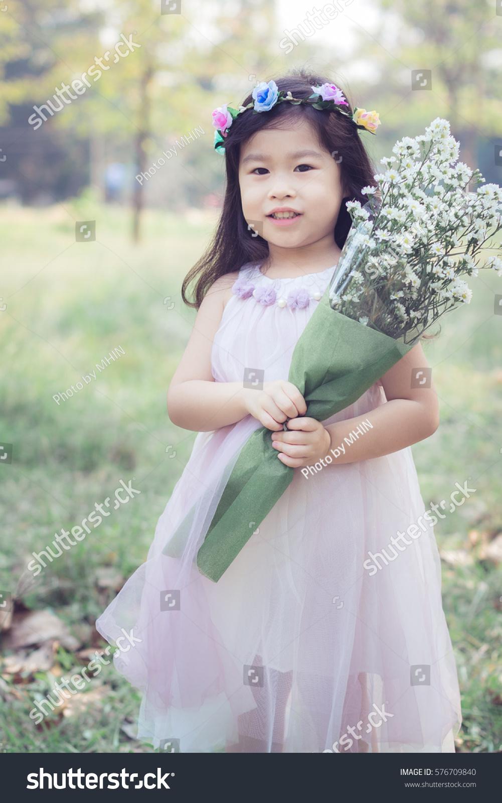 Asian little cute girl flower crown stock photo 100 legal asian little cute girl with flower crown in the garden izmirmasajfo