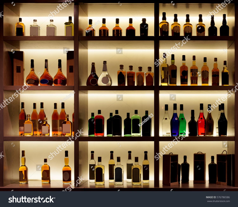 Various Alcohol Bottles Bar Back Light Stock Photo