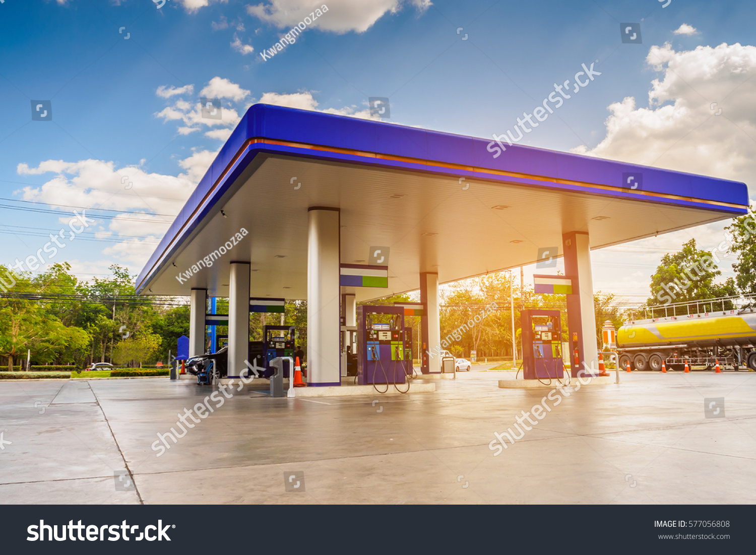 Gas station with clouds sky and sun light #577056808