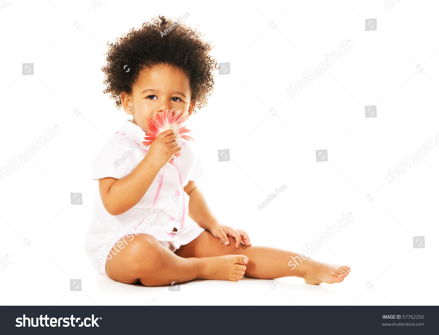 Pretty Little Girl Smelling Flower Isolated Stock Photo Edit Now