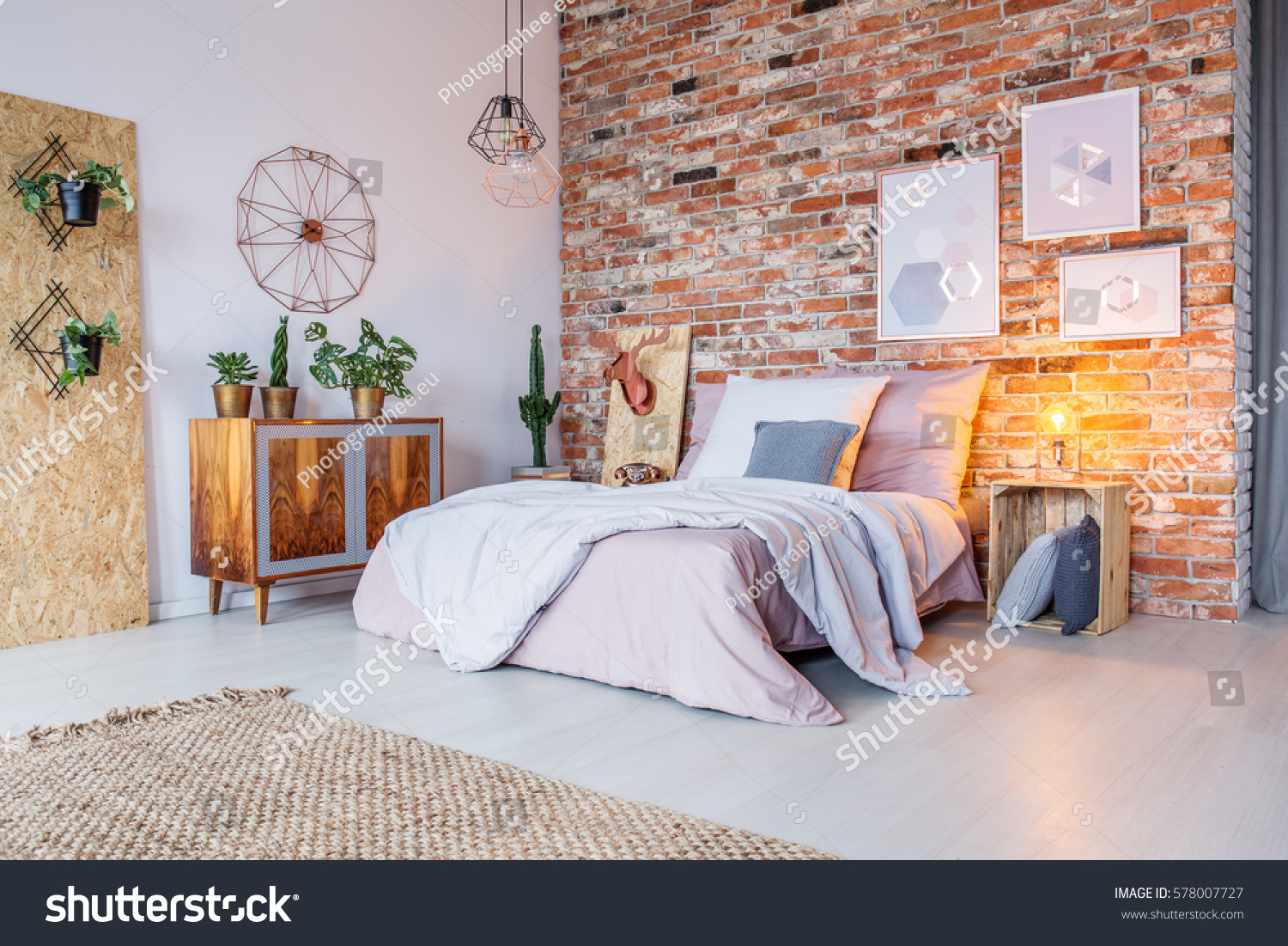 Bright bedroom with double bed  brick wall and rug. Bright Bedroom Double Bed Brick Wall Stock Photo 578007727