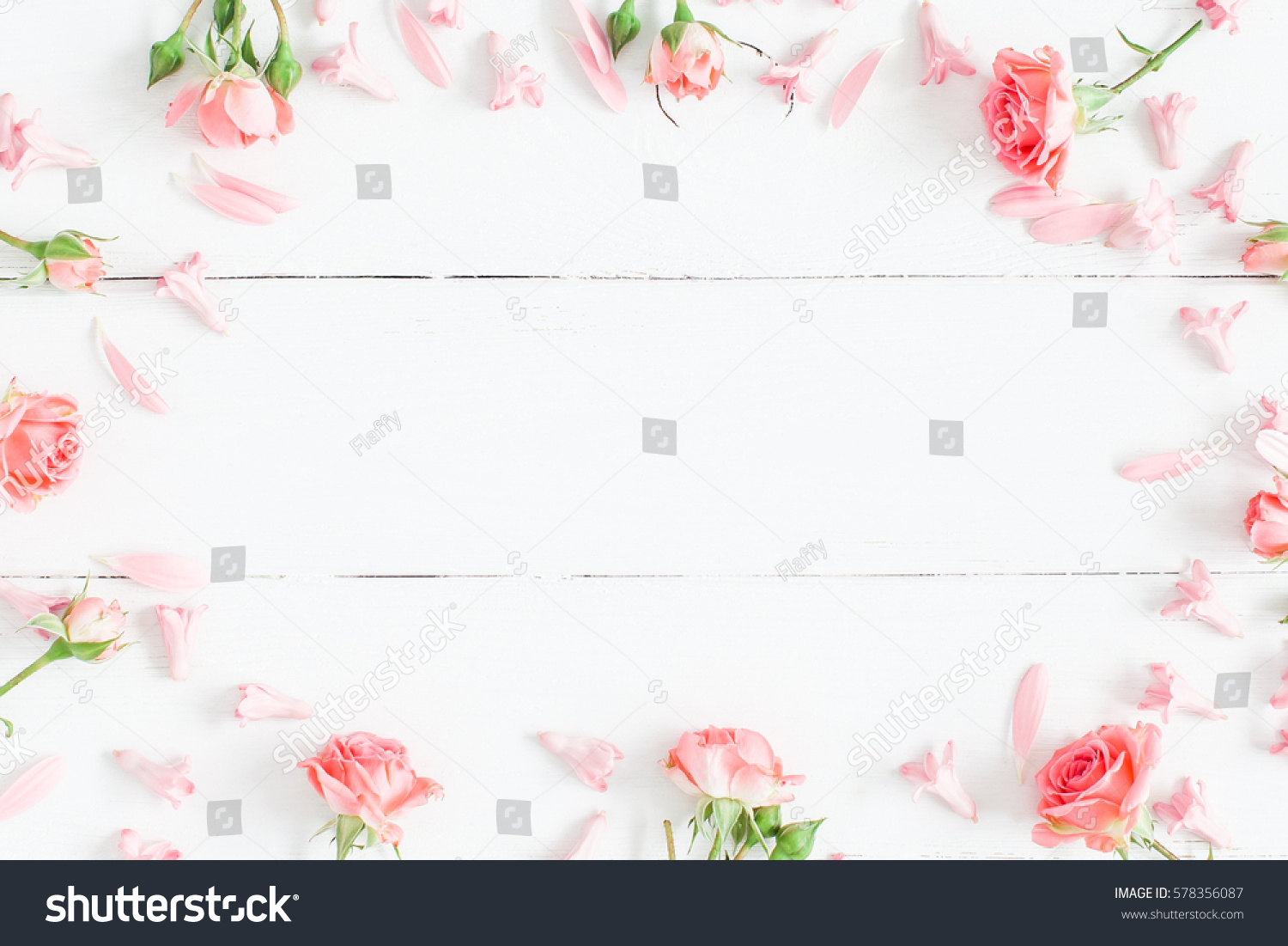 Spring flowers pink flowers on white stock photo royalty free spring flowers pink flowers on white wooden background flat lay top view mightylinksfo Images