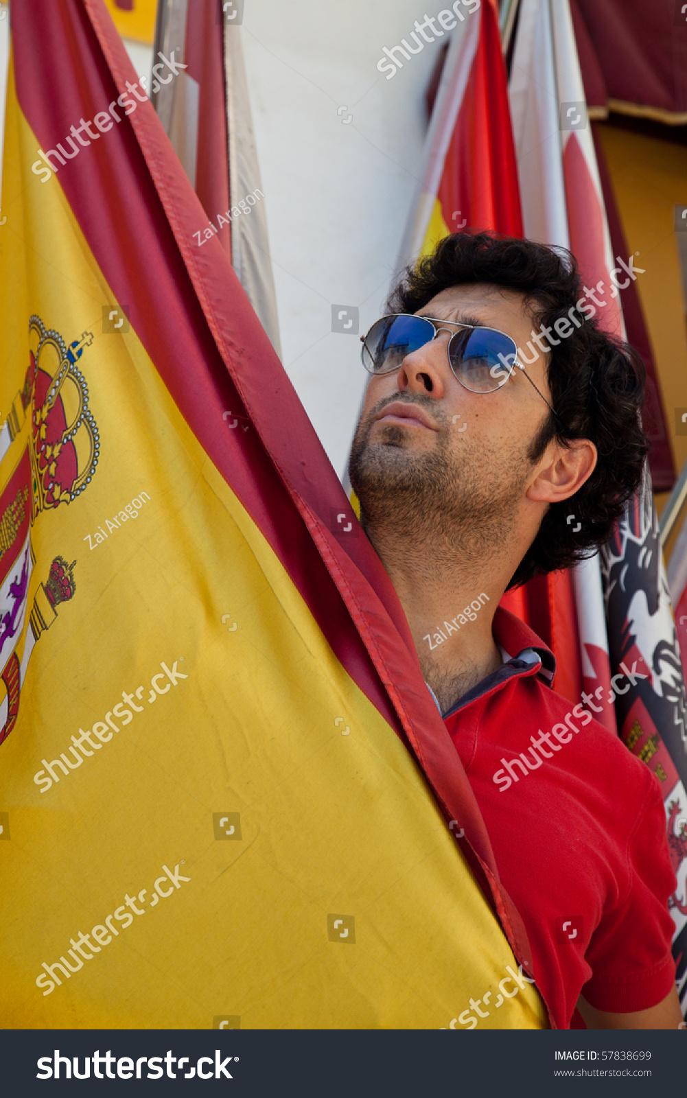 young spanish man holding flag spain stock photo 57838699