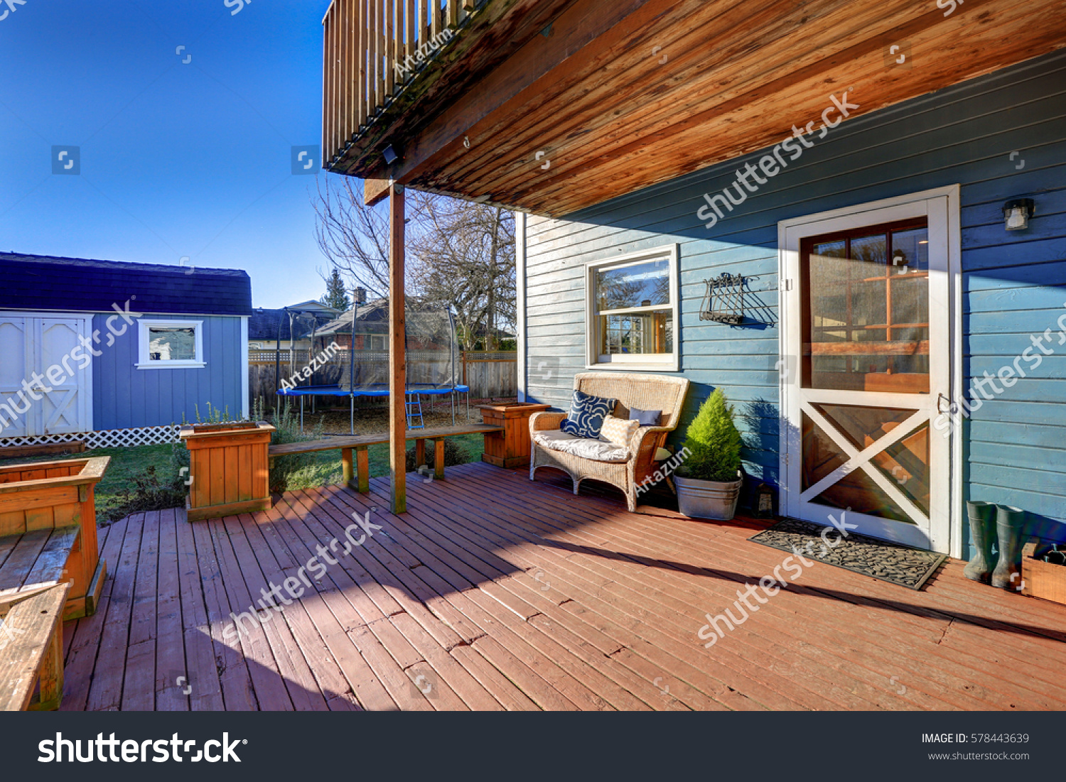 Covered front porch craftsman style home royalty free stock image - Exterior Of Blue Craftsman House With Covered Back Porch Fitted With Nice Wicker Bench Wooden