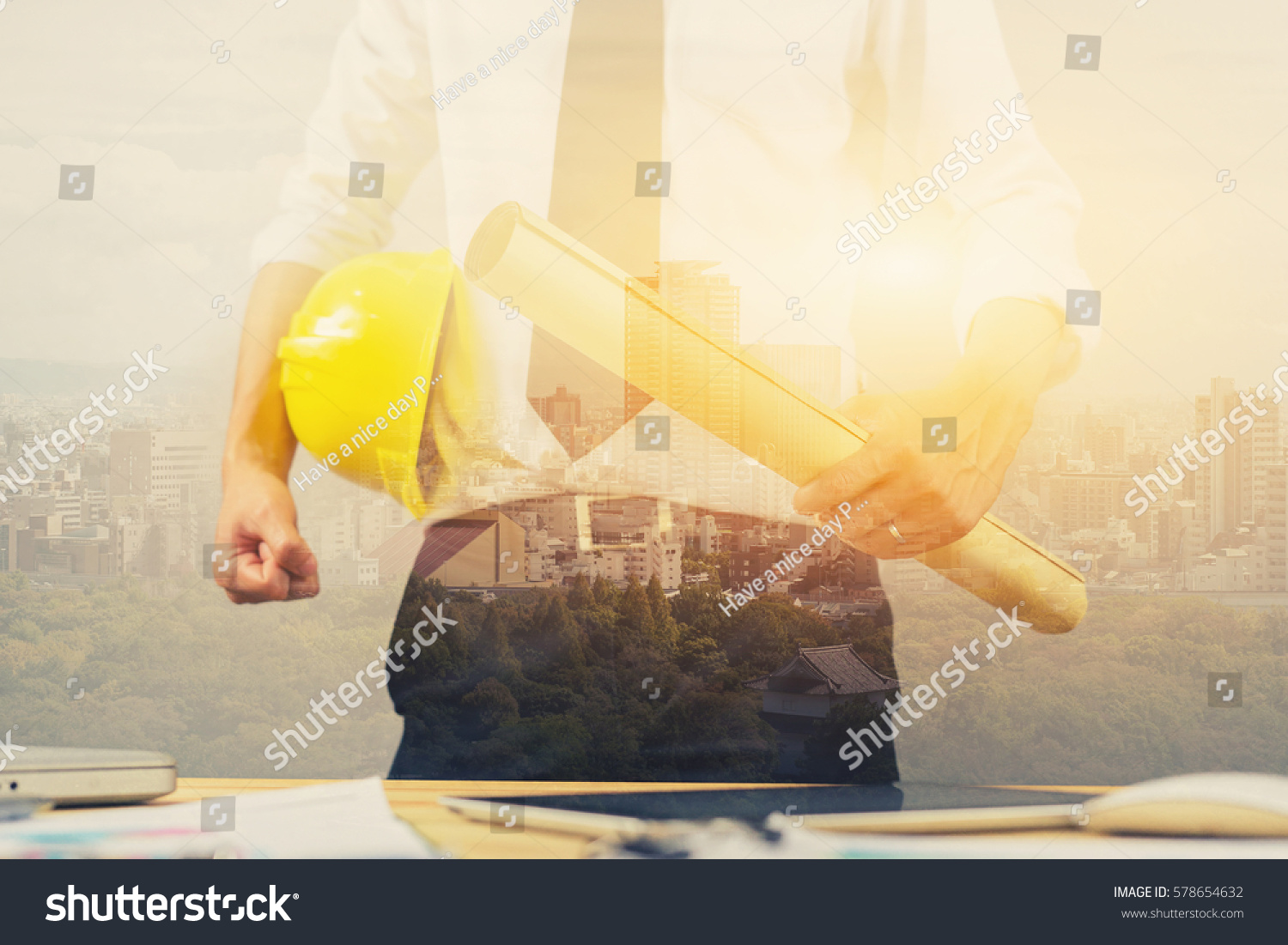 Engineer hold security helmet blueprint paper stock photo engineer hold security helmet and blueprint paper construction drawing plan near laptop computerarchitect working malvernweather Choice Image