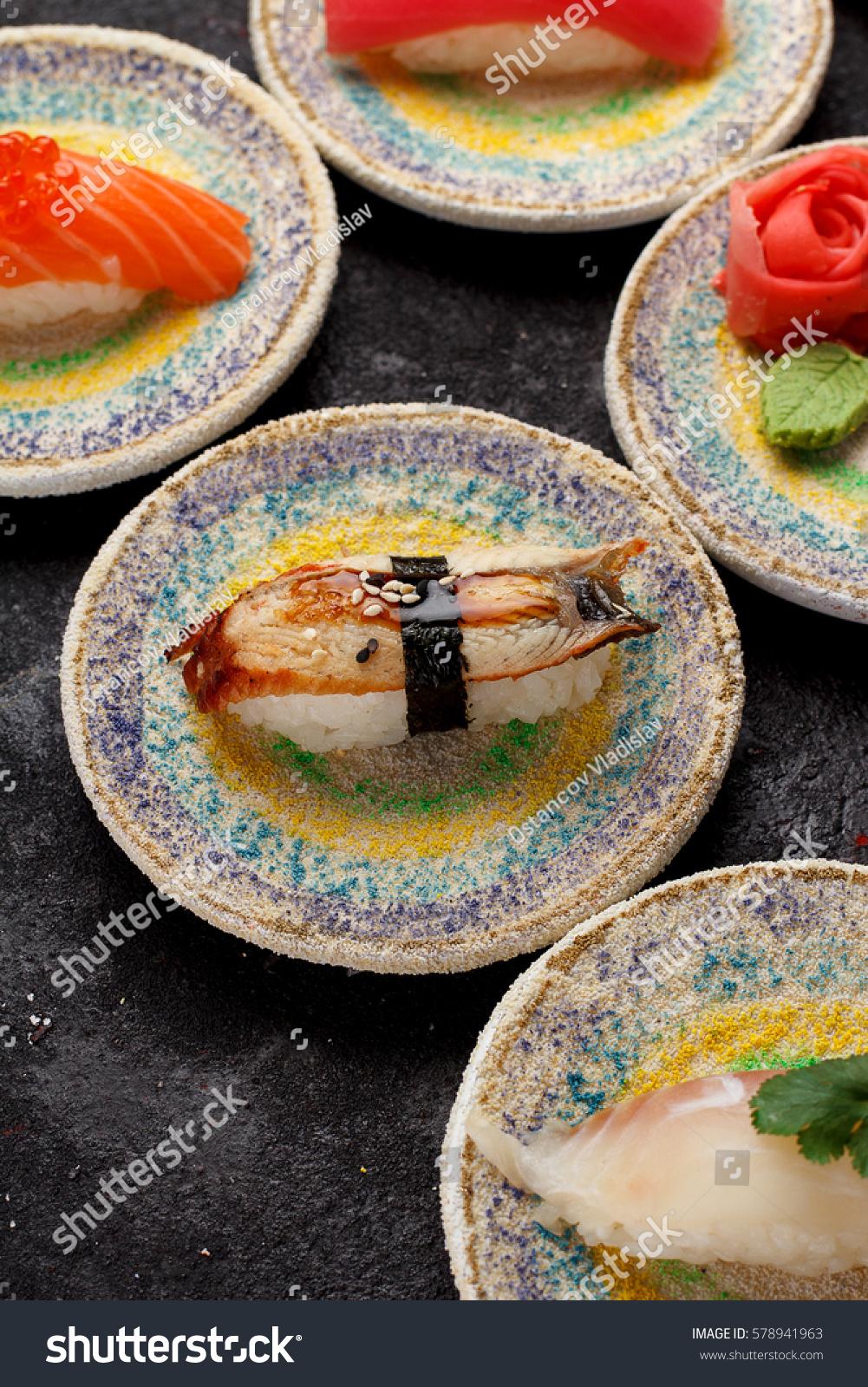 Japanese cuisine. Sushi on a decorative plates over dark concrete background. & Japanese Cuisine Sushi On Decorative Plates Stock Photo (Royalty ...