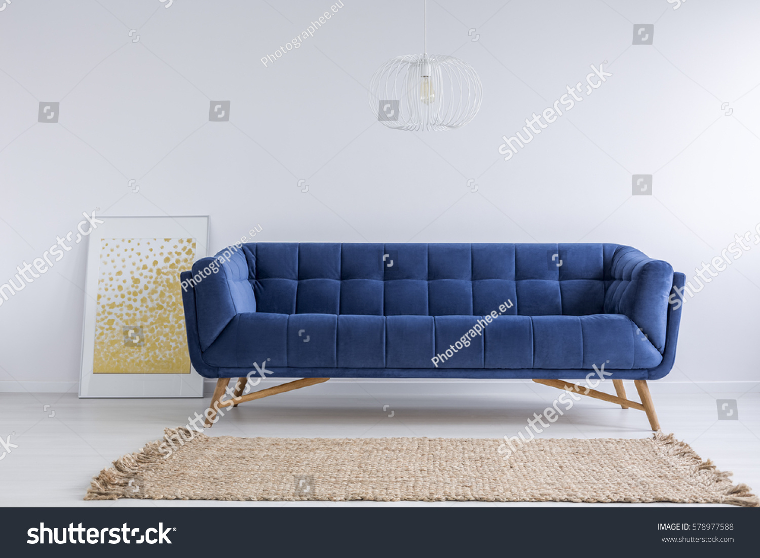 Simple white room blue sofa rug stock photo 578977588 for Blue and white sofa