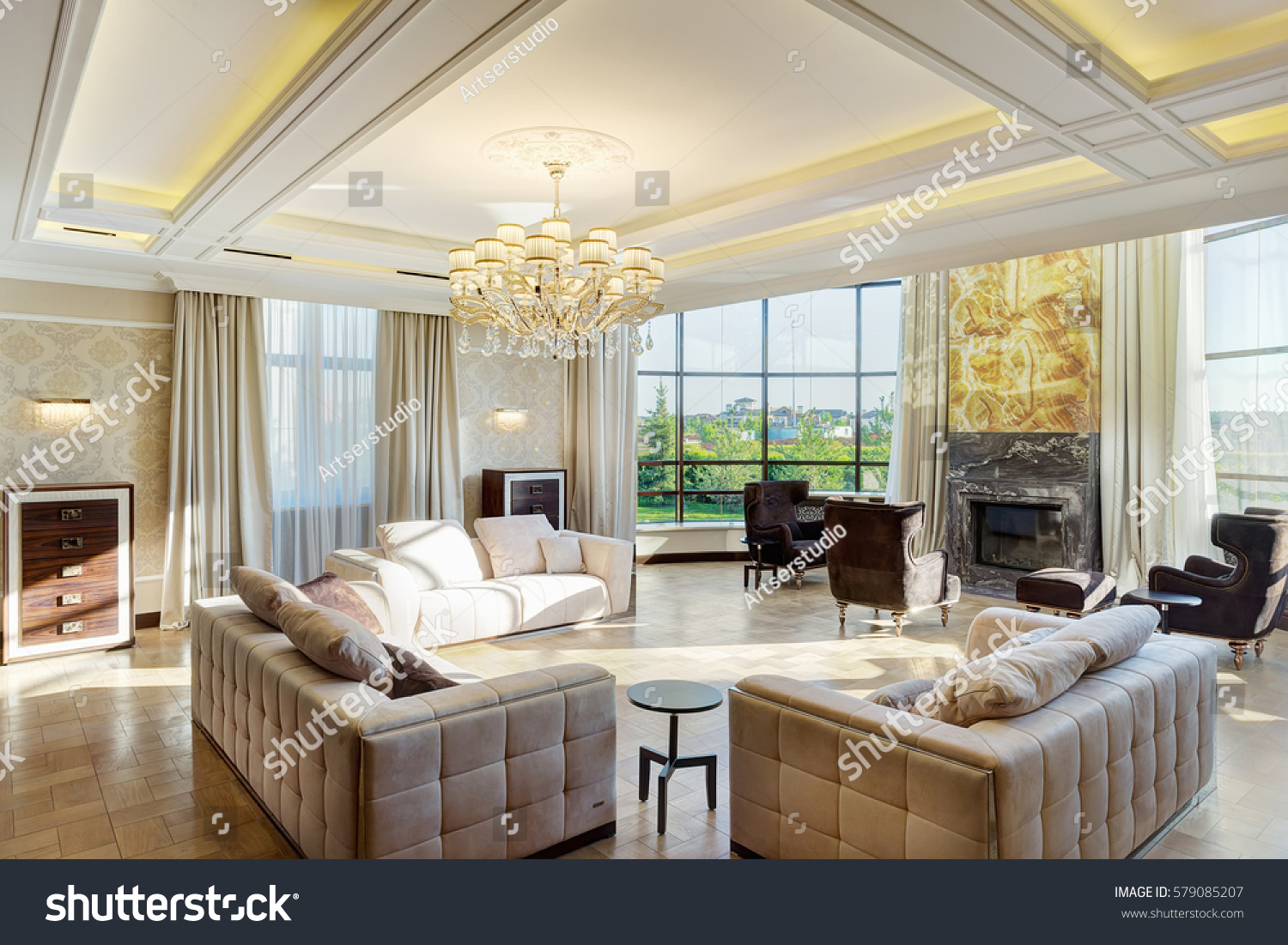 Luxury living room fireplace - Luxury Living Room With Big Windows With Panoramic View Of Garden And Crystal Chandelier In Center