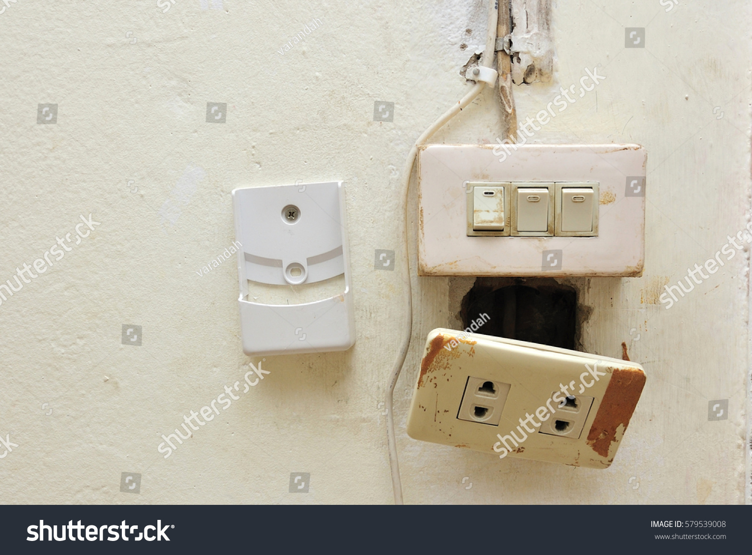 Light Switch Electrical Socket Damaged Stock Photo Edit Now Ac Wiring A And With On The Wall