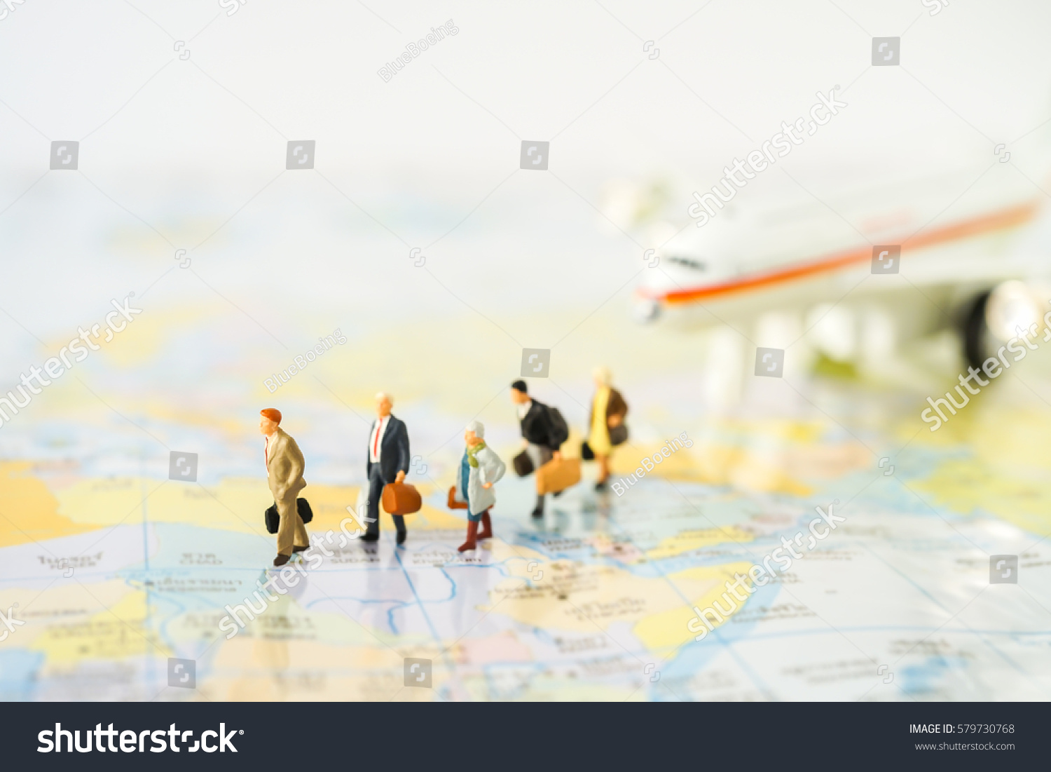 Miniature business people businesses team walking stock for Waldo s world wide travel service