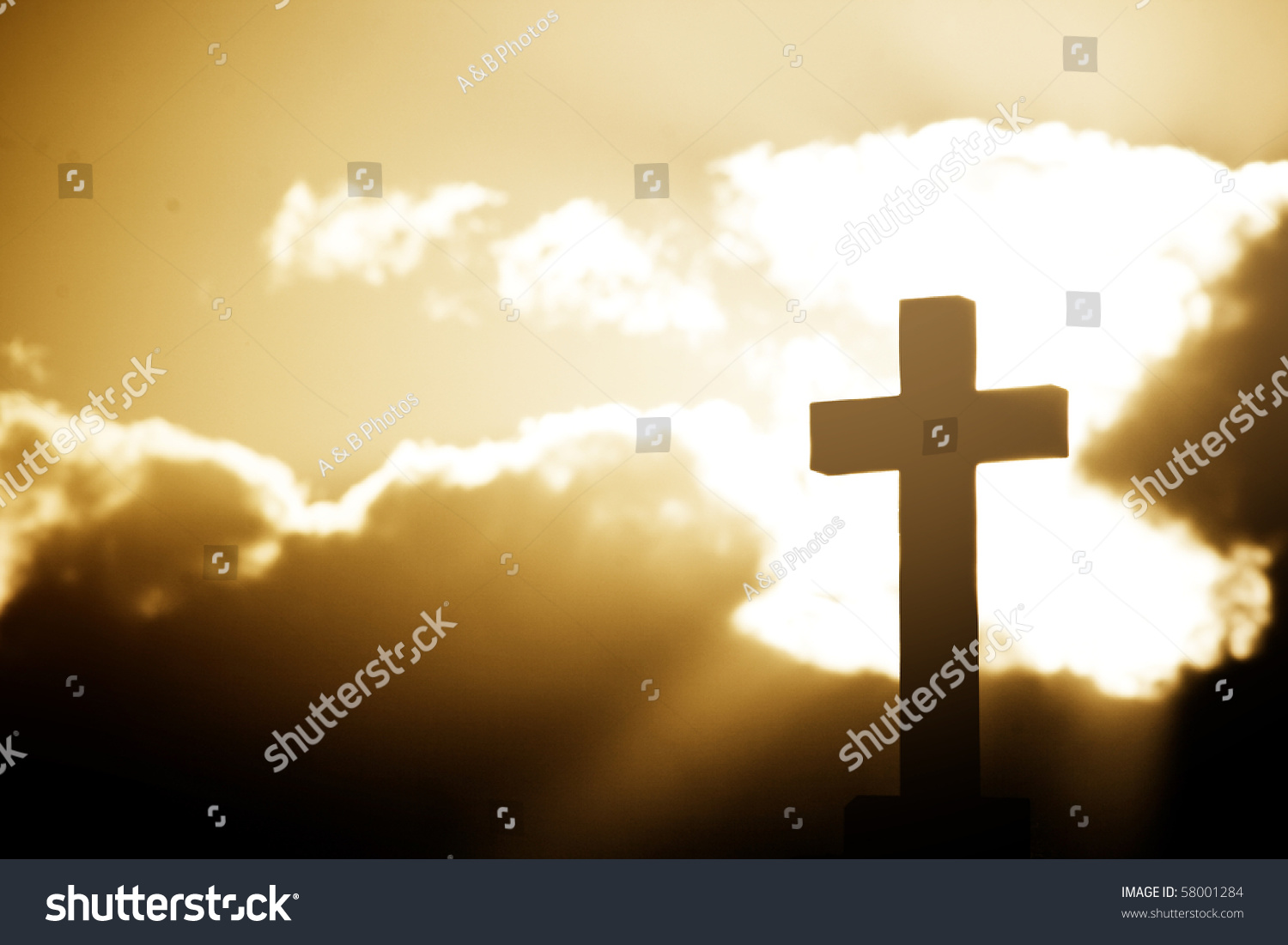 Silhouette of the holy cross on background of storm clouds stock - Silhouette Of A Cross In Beams Of Light