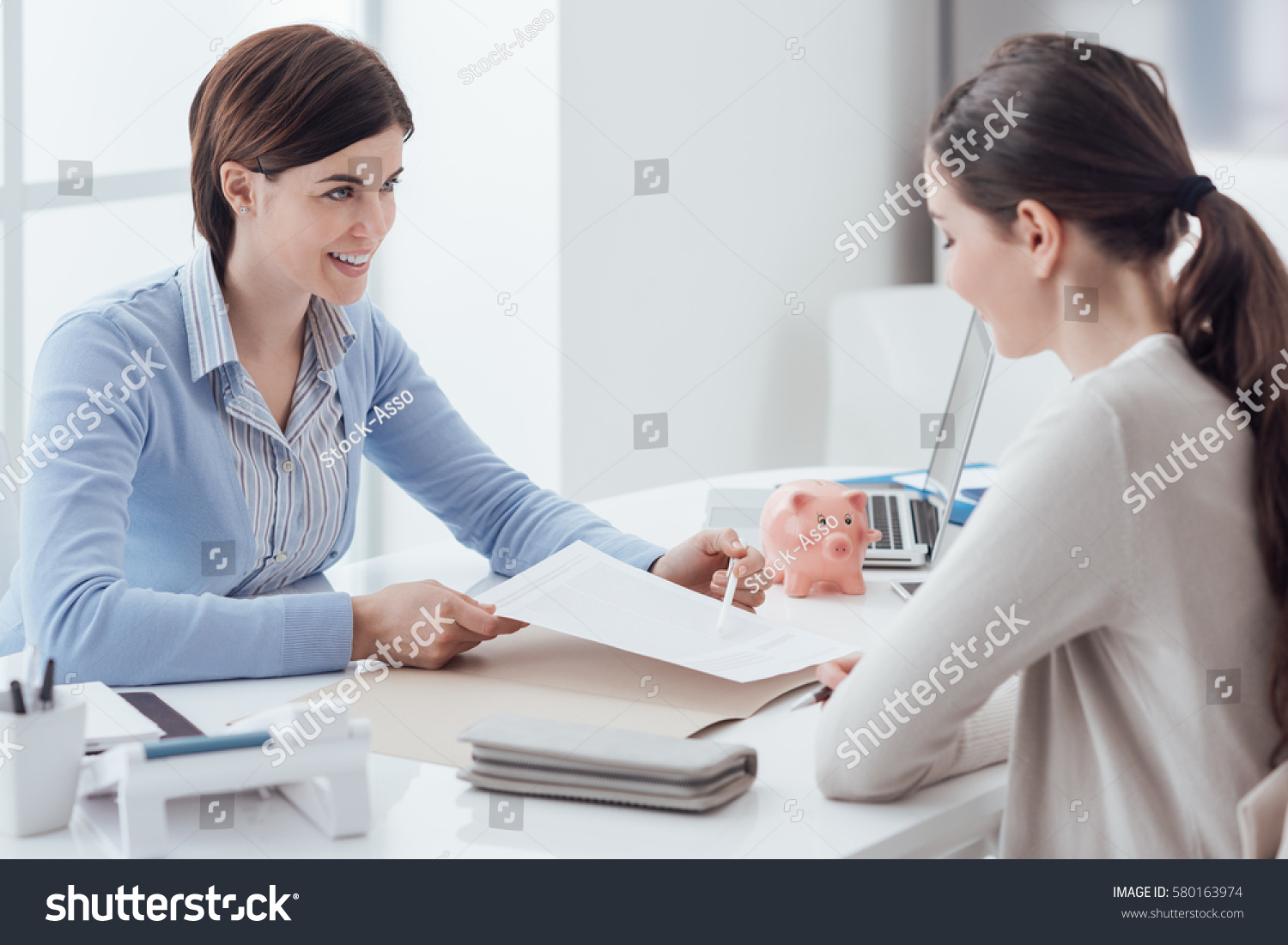 the office the meeting. business consultant and customer meeting in the office businesswoman is holding a contract e