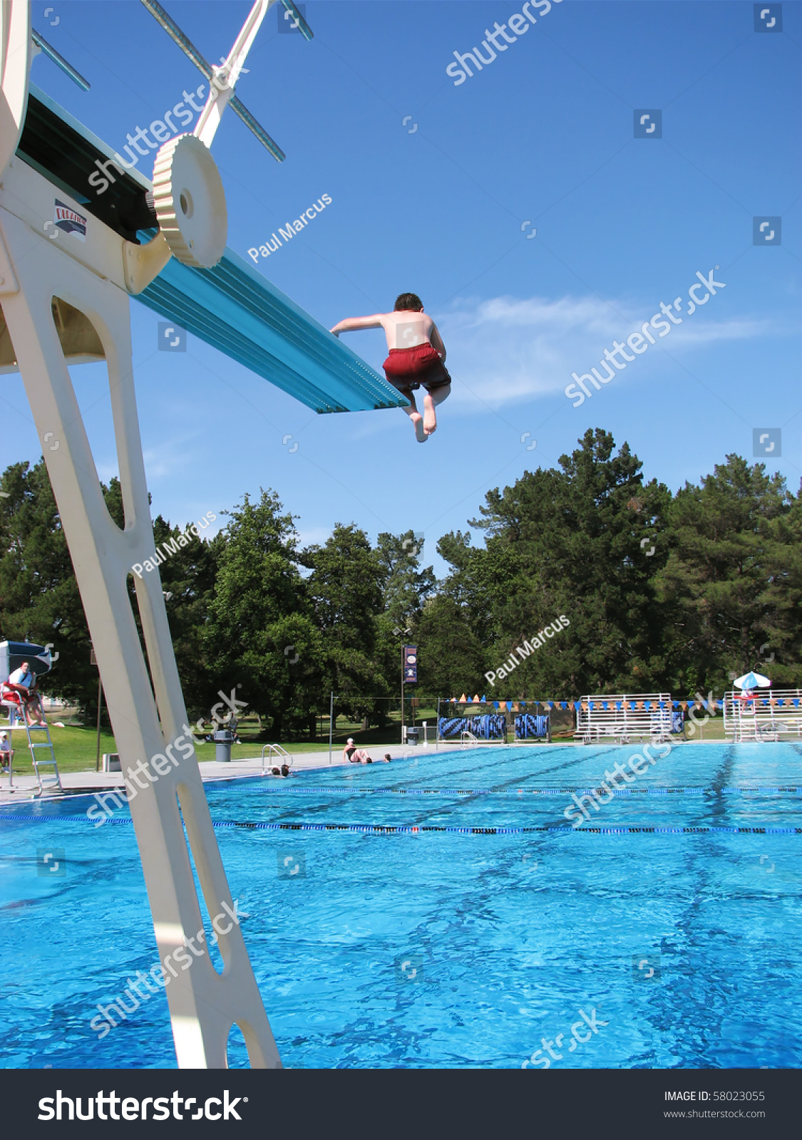 Boy Jumping Off High Diving Board Stock Photo 58023055 - Shutterstock