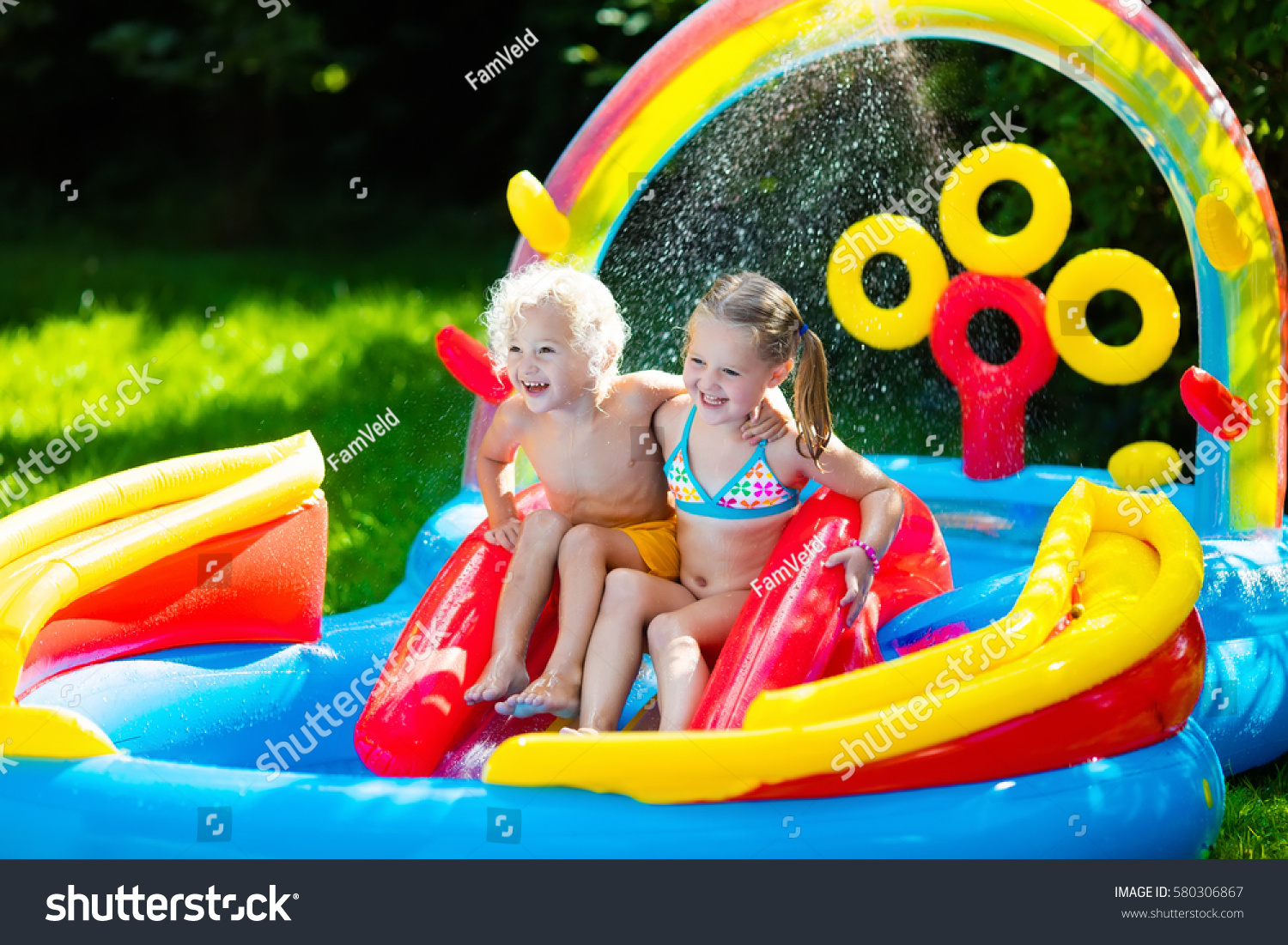 children playing inflatable baby pool kids stock photo 580306867