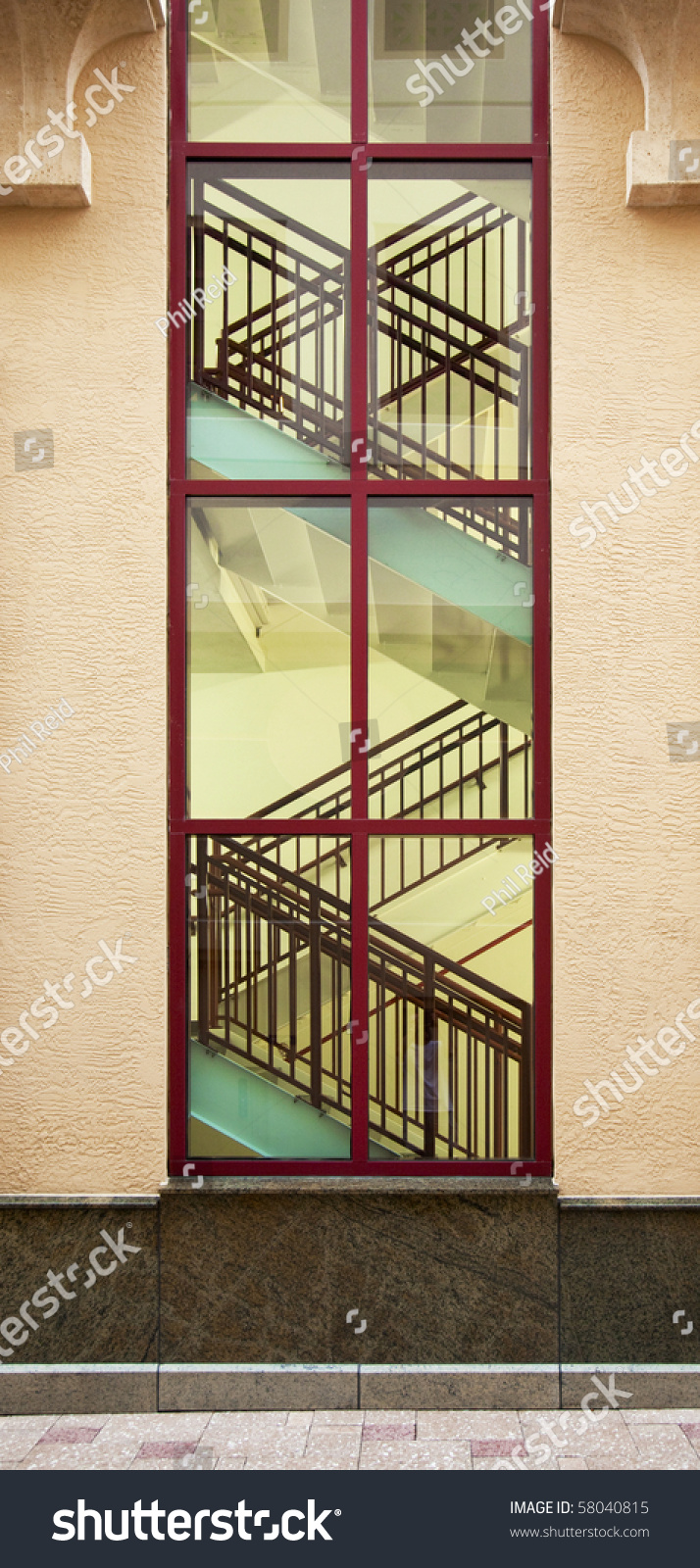 Interior Stairs As Seen Through Large Window From Outside