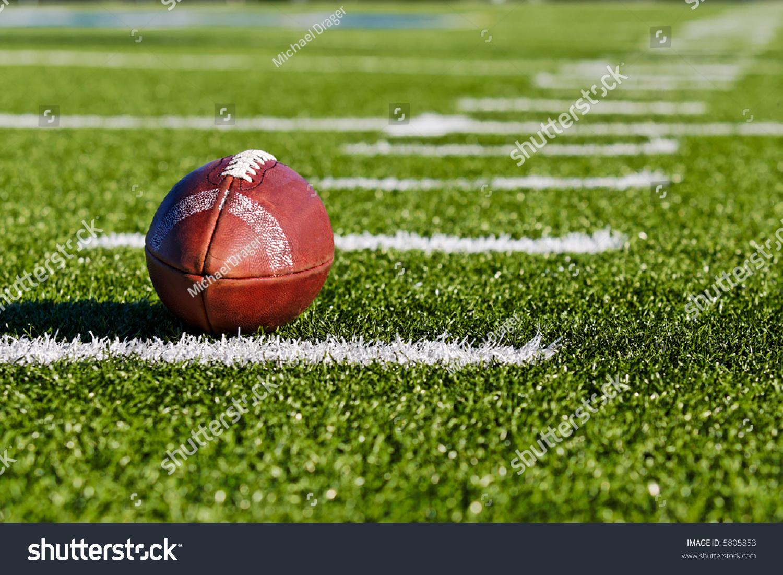 Football On Yardage Marker Low Angle Stock Photo Edit Now 5805853