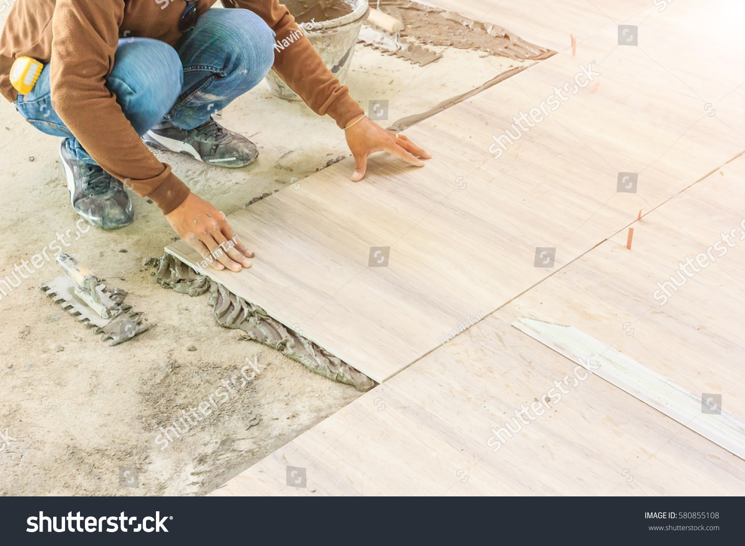 Floor Tile Workers : Home improvement renovation construction worker tiler