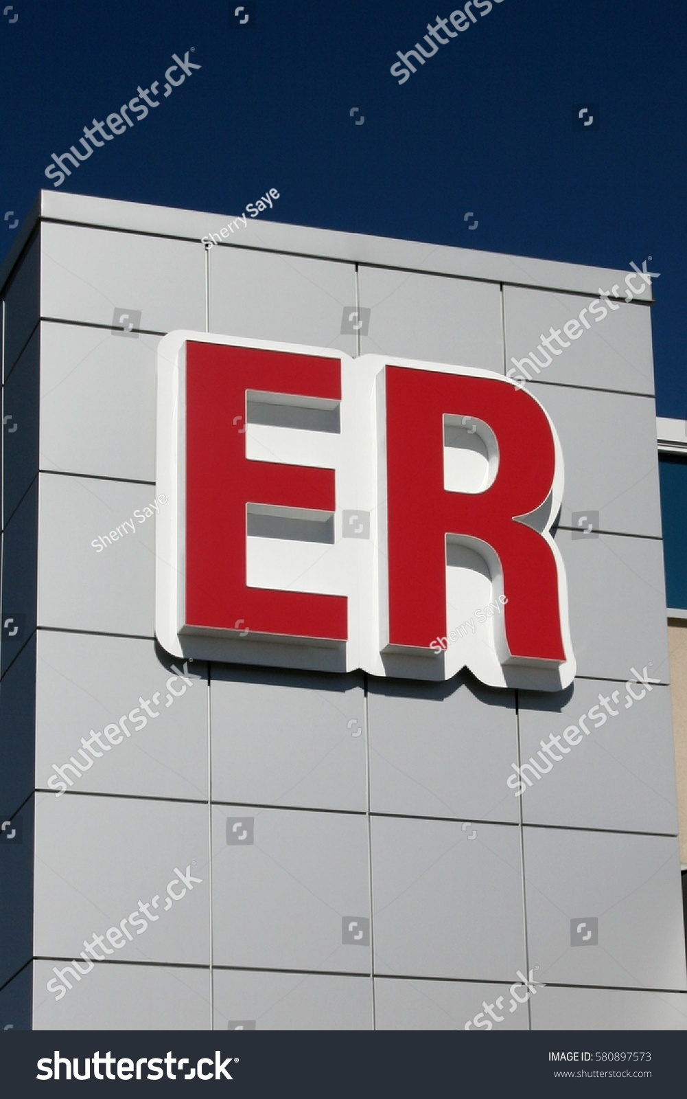 Abbreviated emergency room er sign above stock photo 580897573 abbreviated emergency room er sign above entrance against blue sky buycottarizona Images