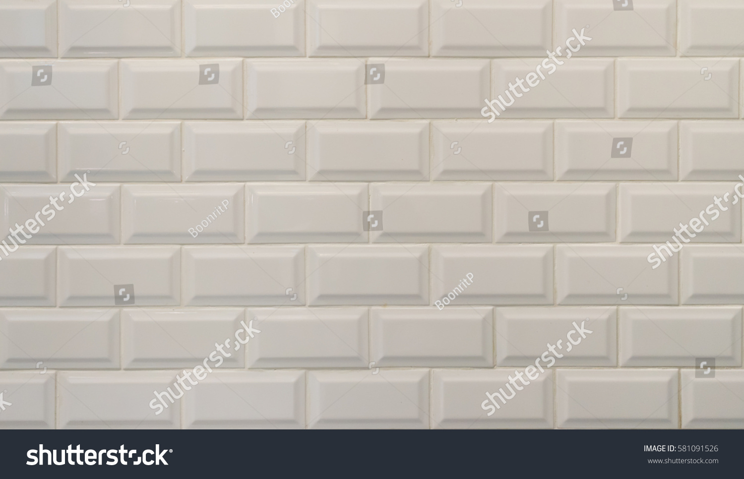 White ceramic tiles texture imitating white stock photo 581091526 white ceramic tiles texture imitating white bricks suitable for background and decoration dailygadgetfo Image collections