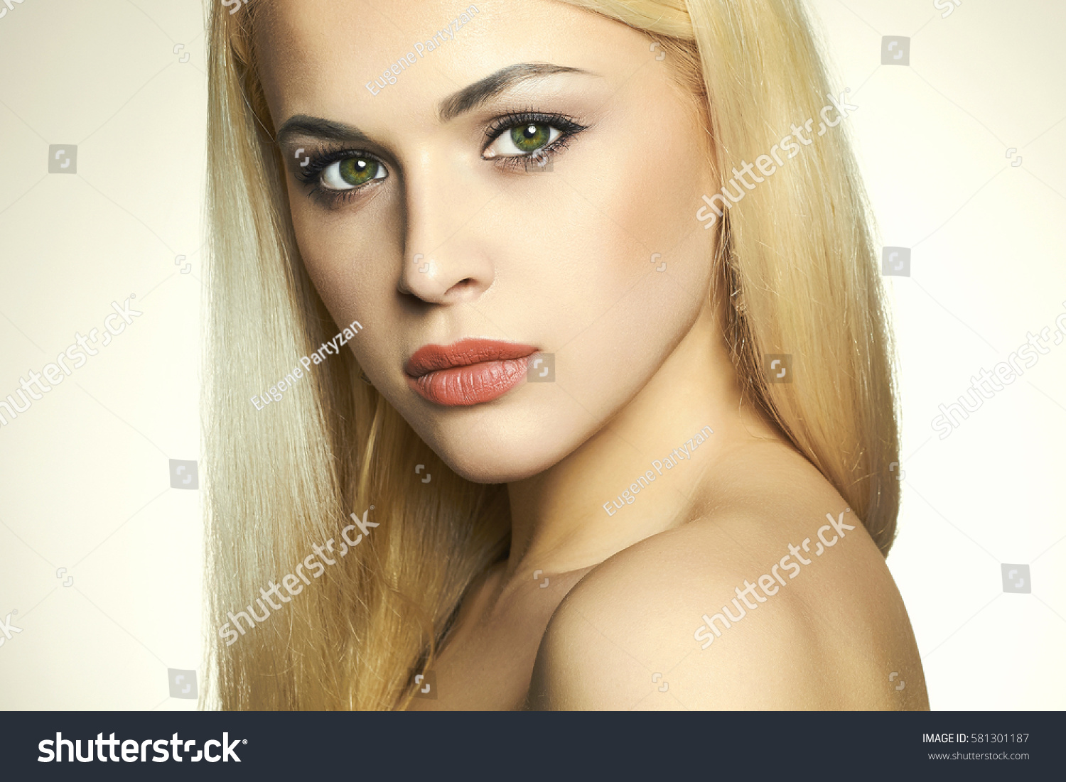 Blonde Girl With Green Eyes