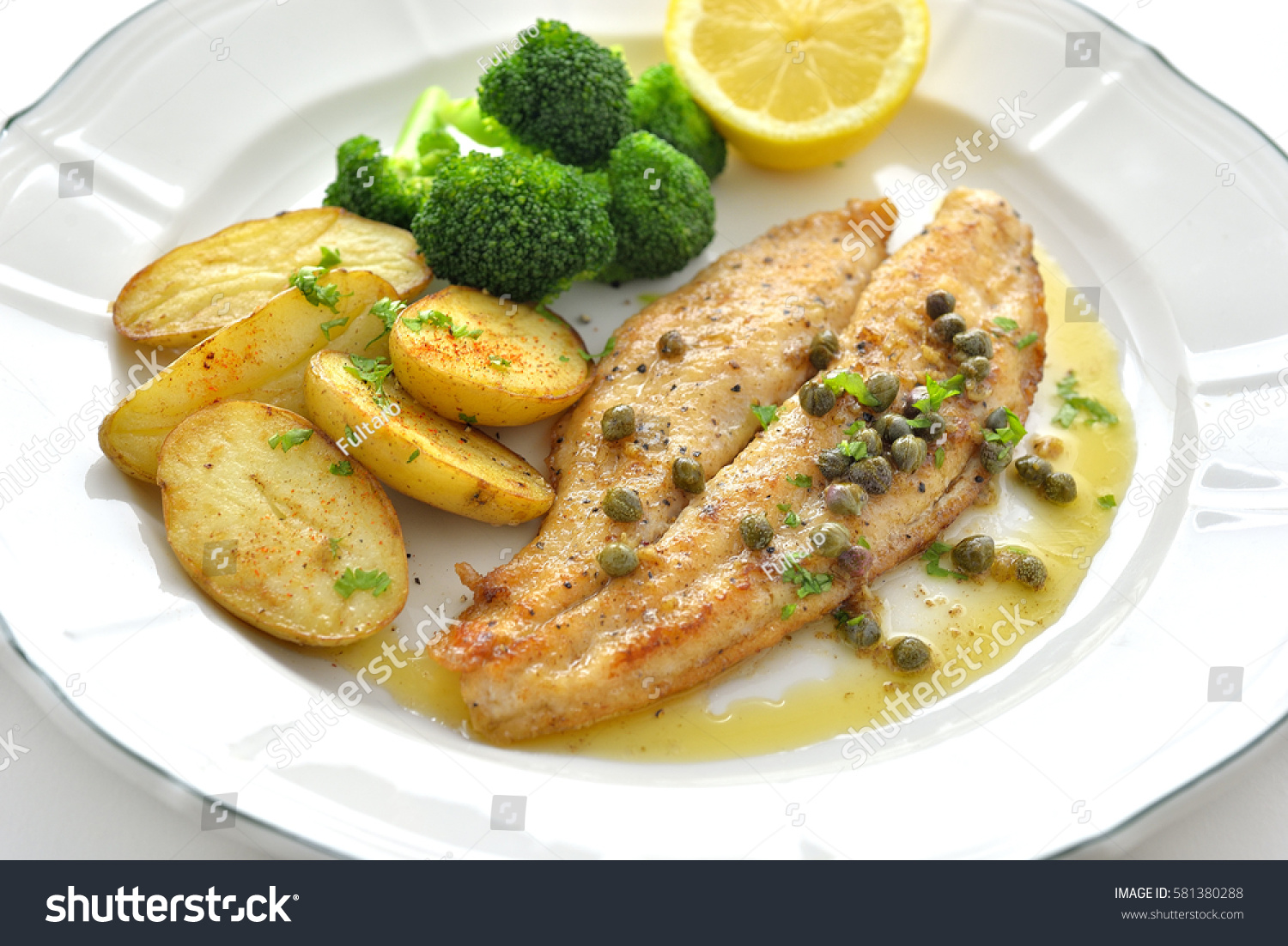 Pan fried white fish brown butter stock photo 581380288 for Lemon butter caper sauce for fish