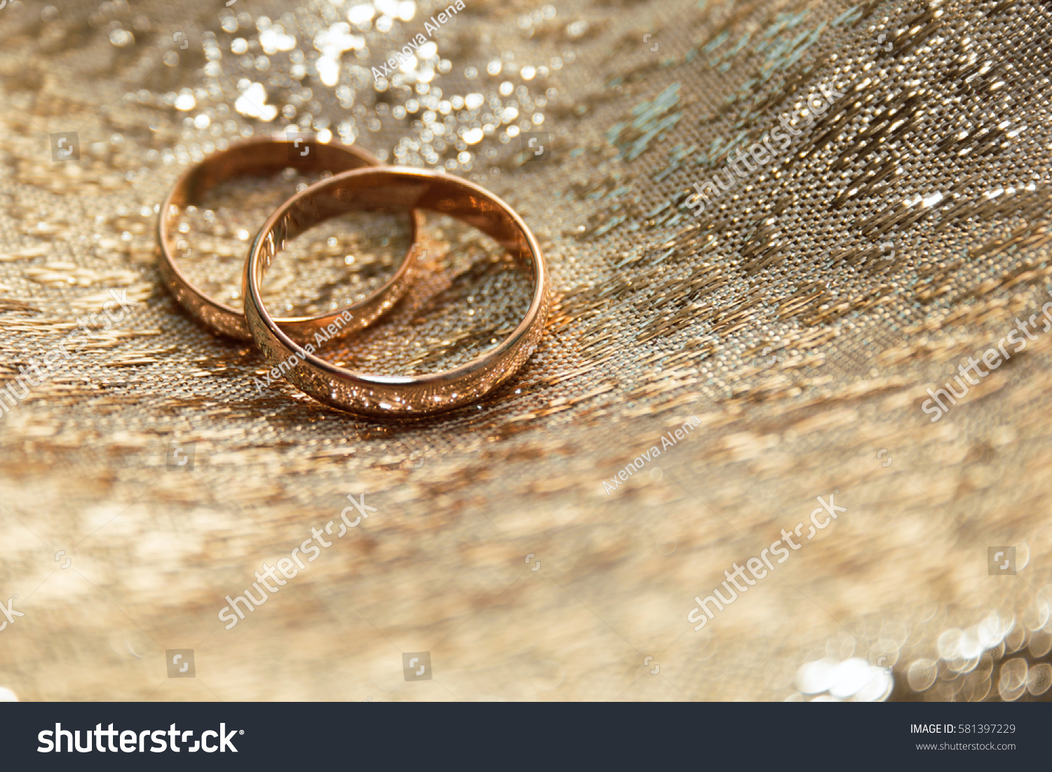 Gold Wedding Rings On Gold Cloth Stock Photo Edit Now 581397229