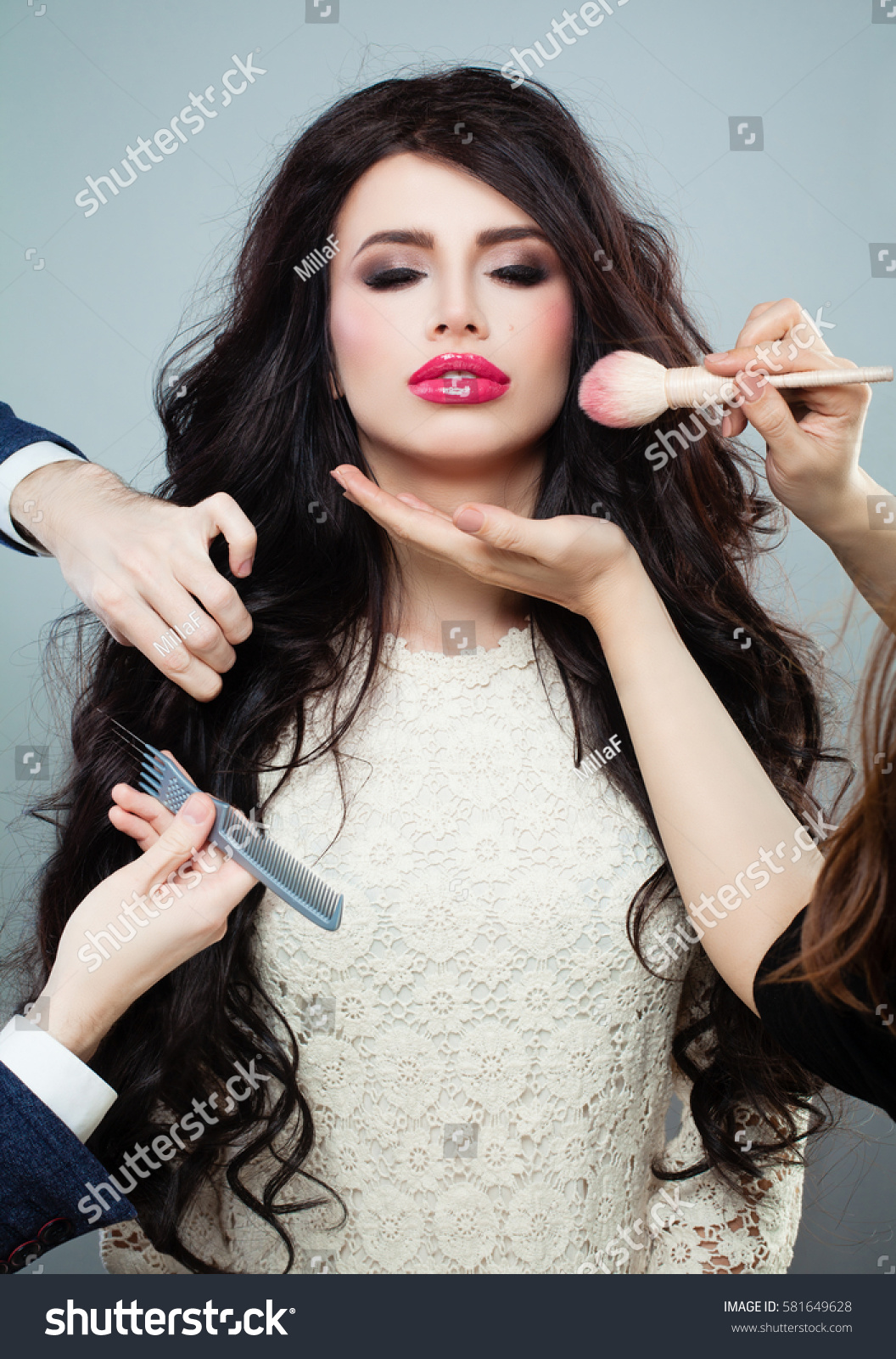 professional hair stylist and makeup artist doing make up and hairstyle with makeup brush and comb - Professional Hair Stylist