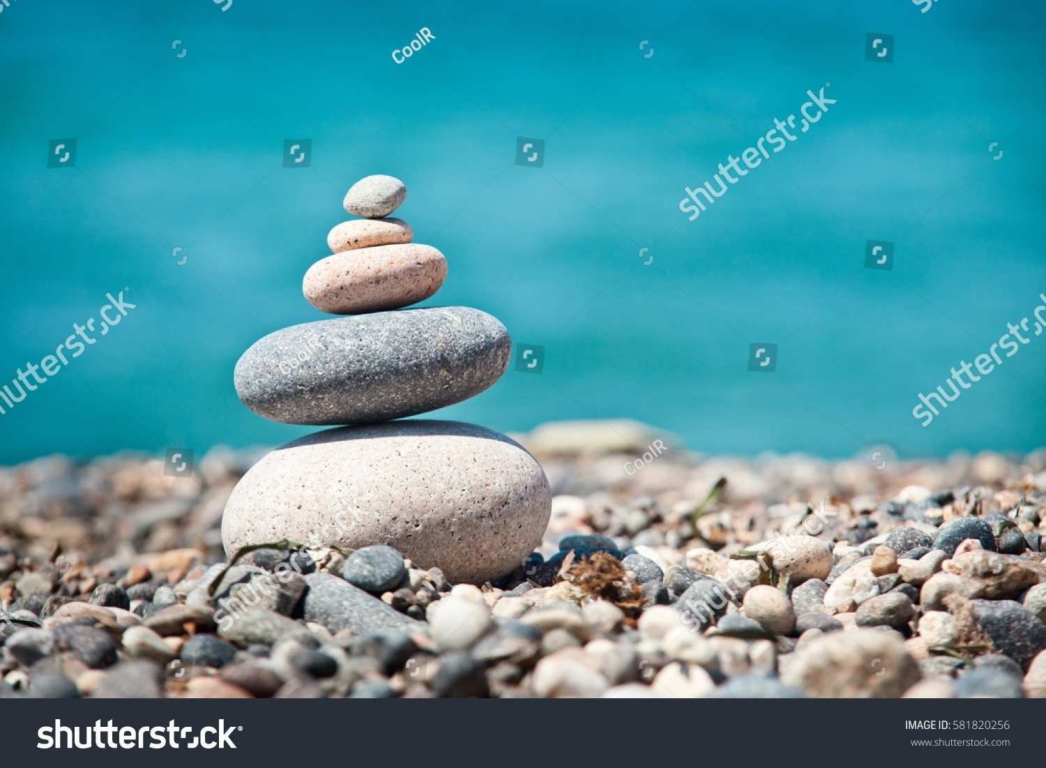 cairn on background sea beach sand stock photo (100% legal