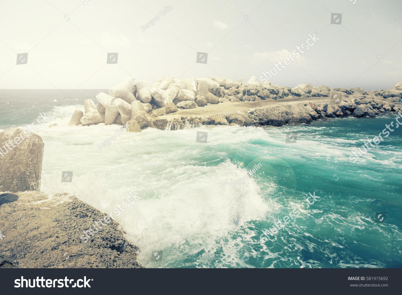 Dangerous Waves Crashing On Rocks On Stock Photo (Edit Now