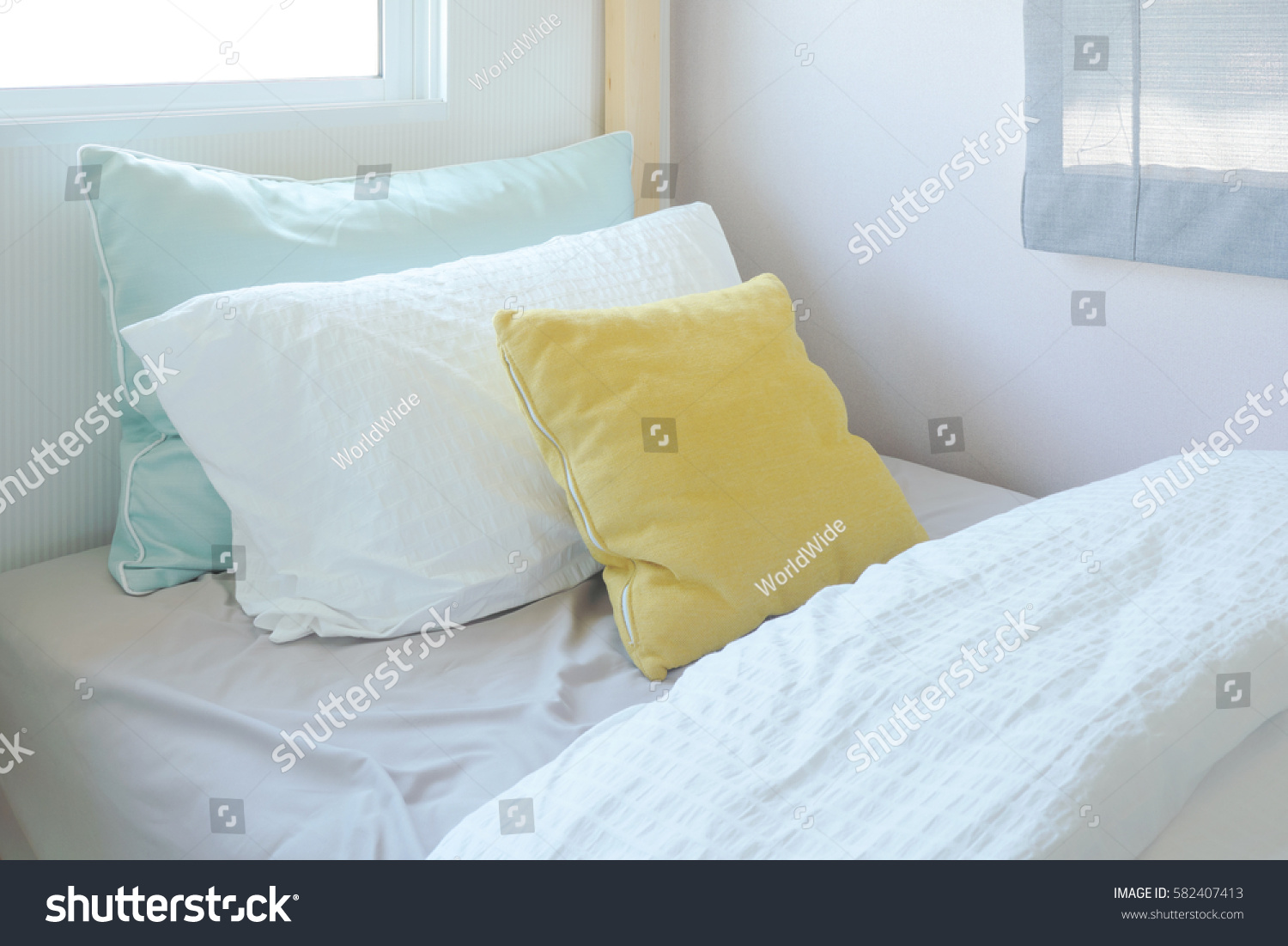 Yellow Green Pillow On Tiny Bed Stock Photo Edit Now 582407413