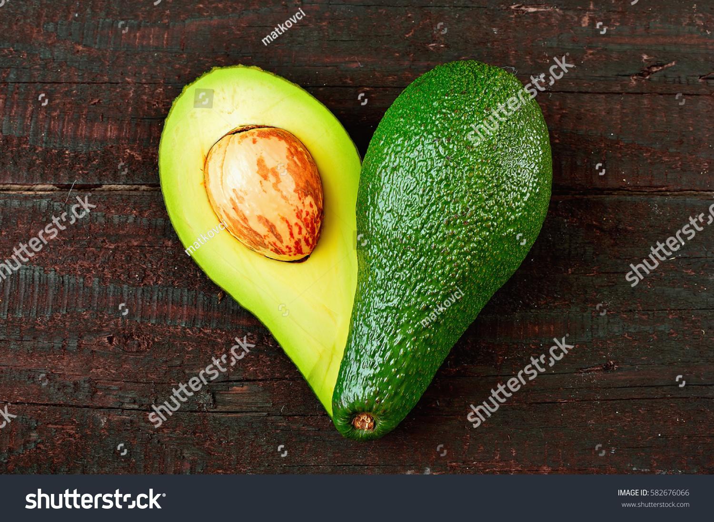 Fresh avocado shape heart isolated on stock photo 582676066 fresh avocado in the shape of a heart isolated on wood table background love symbol biocorpaavc