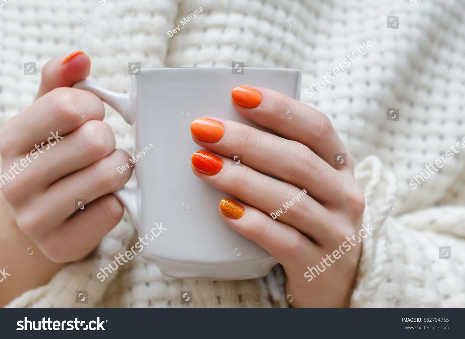 Female hands orange nail design holding stock photo 582704755 female hands with orange nail design holding white cup prinsesfo Images